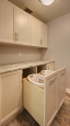 Laundry Room with Pull Out Hampers